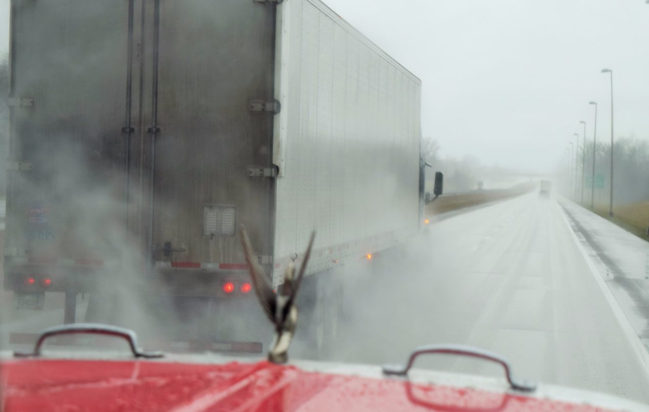 Truck on the Highway in the Rain